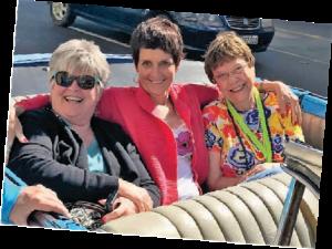 Celeste and friends in a classic car