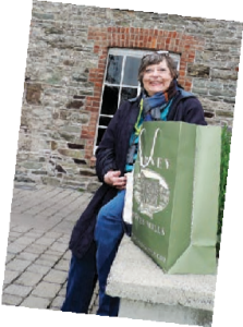 woman sitting on bench with shopping bag