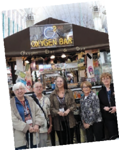 "ladies standing in front of an ""Oxygen Bar"""