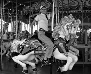 Marilyn Sundt on the carrousel in Magic Kingdom, Disneyworld