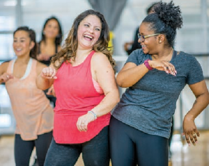 women taking a dance style workout class