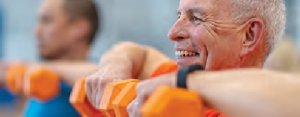 older man working out with weights