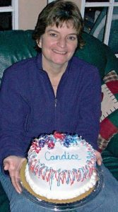 woman holding birthday cake