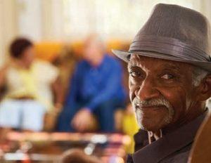 older man in fedora hat